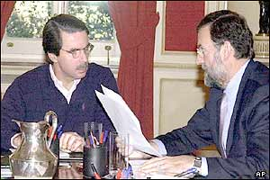 Spanish Prime Minister Jose Maria Aznar (left) and Deputy Prime Minister Mariano Rajoy during the crisis committee meeting