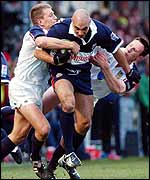 Brendon Daniel is tackled by Swansea's Shaun Payne and Mark Taylor