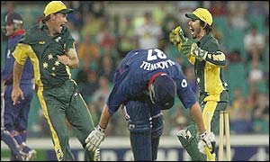 Ian Blackwell is run out by Australia's Jimmy Maher and Ryan Campbell