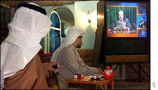 Kuwaiti men watch TV broadcast of Saddam statement