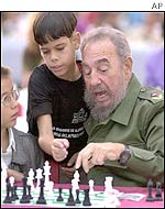 Cuban President Fidel Castro (left) ponders his move