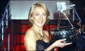Paula Radcliffe poses with her trophy