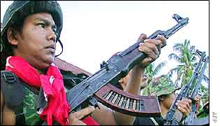 A soldier of the Free Aceh Movement (GAM) rebels displays his rifle at a rebel-held village in Bireuen district, Aceh