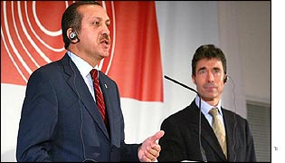 Recep Tayyip Erdogan and Danish Prime Minister Anders Rasmussen speaking to reporters