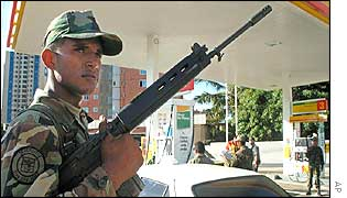 A soldier guards a petrol station in Maracaibo
