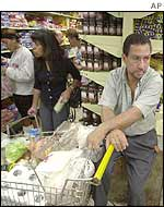 Shoppers stock up in a Venezuelan supermarket