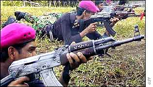 The Free Aceh Movement (Gam) rebels fire their guns during military training at rebel-headquarters in Aceh
