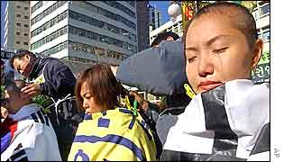 Protesters have their hair cut during an anti-US rally at a church in Seoul, Tuesday, 10 Dec. 2002