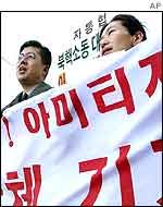 Protesters shout a slogan during an anti-US rally to oppose Mr Armitage's visit near the US embassy in Seoul