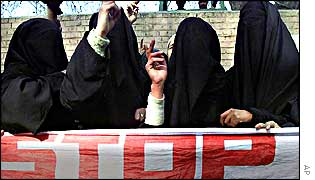 Women in Kashmir holding up banner