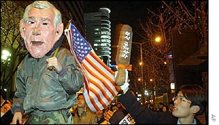 Protestors in South Korea with an effigy of George W Bush