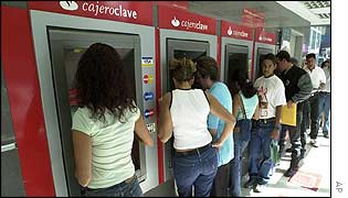 Venezuelans queue at cash machines in Caracas