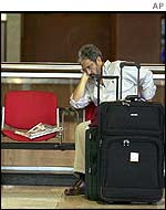 A passenger waits at the Simon Bolivar airport in Caracas
