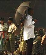 Shipbreaking yard boss (with umbrella) in Chittagong