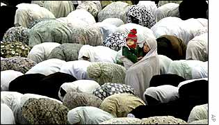 Women in Iran pray during Eid