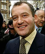 Paul Burrell celebrates his court victory
