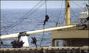 Marines descend by rope onto the So San's deck