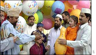 Children are bought balloons in Karachi for the Muslim feast of Eid al-Fitr
