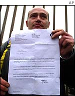 A Fiat worker shows his letter of temporary dismissal