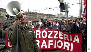 Fiat workers protest at the Porta Nuova train station near the Mirafiori plant in Turin