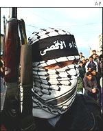 Palestinian militant from the al-Aqsa Martyrs Brigade at a funeral in Gaza