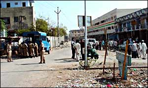 The road dividing the Muslim Juhapura neighbourhood (right) with Hindu Vejalpur (left) - police were called in to calm tension.