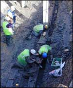 Workers excavating the ship