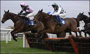 Gunther McBride leads the way in a hurdle race at Kempton