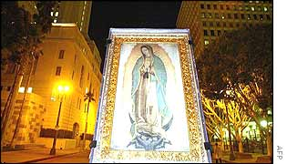 Replica of an icon of the Virgin of Guadalupe is carried in Los Angeles