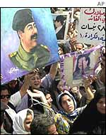 Iraqis attend a Saddam rally in Baghdad