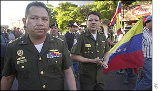 Army officers march with opponents of Hugo Chavez