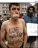 Asylum seeker protests in a park in Calais