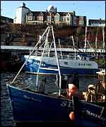 Trawler at quayside   PA