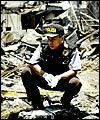 An Indonesian police officer surveys the ruins of the Bali bombing