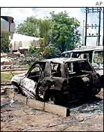 Burnt-out cars after the attack on the Paradise Hotel