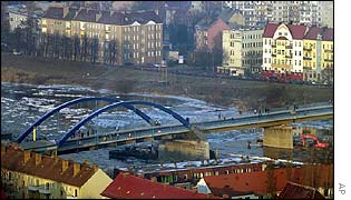 People cross the new City Bridge (Stadtbruecke) across the river Oder between the German city of Frankfurt, left, and Polish city of Slubice