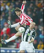 Southampton's Rory Delap and Alan Shearer clash