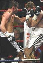 Joe Calzaghe (left) lands a left hand on Tocker Pudwill