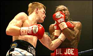 Ricky Hatton pounds his opponent
