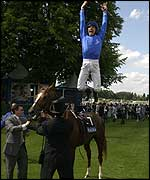 Frankie Dettori performs his trademark dismount off Grandera at Royal Ascot