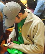 Teenager using mobile phone