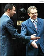 Syrian President Bashar al-Assad (left) and UK Prime Minister Tony Blair