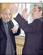 President Karzai (L) with Norway's Foreign Minister Jan Petersen in Oslo