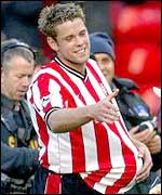 James Beattie claims the match ball after his hat-trick against Fulham