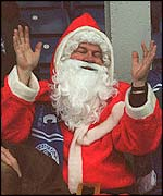 A football fan dressed as Santa Claus