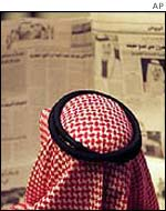 Saudi man reading newspaper