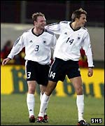 Alexander Voigt (left) scored Germany's late equaliser