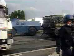 Photograph of French riot police and the blockaded A1 motorway