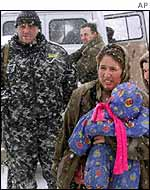 Refugee at checkpoint in Chechnya