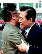 South Korean President Kim Dae-jung (right) is embraced by North Korean leader Kim Jong-il during a departure ceremony at Pyongyang airport 15 June 2000